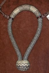 """Bill Black              3/4"""" rawhide bosal                      The 3/4 inch diameter bosal is made of 20 plait with 40  plait 7.5 inch swelled nose button. Inside length is 10.5 inches on the tag. It  has a three strand twisted reata core and a plug in the heel knot. The body is  braided of brown leather. The rawhide buttons have brown dyed rawhide  interweaves"""