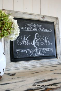 Chalkboard wedding sign. Looks like a cabinet door repurposed. Love it!