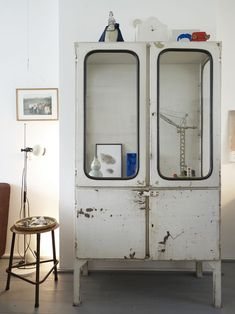 Cabinet which appears to be fashioned from the doors of a bus or train? // home of Renee Mennen from Studio rENs