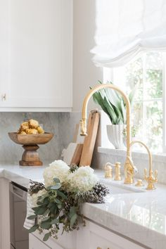 Chic White Kitchen with gold hardware 2