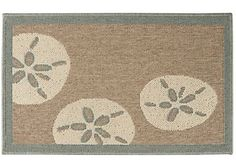 The Bacova Sand Dollar Accent Rug is perfect for indoor or outdoor use and features skid resistant latex backing. This durable Berber accent rug features a sand dollar design and measures 20 x 33 inches.