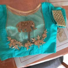 Jun 2019 - With the right kind of blouse, you can up your silk saree's glam quotient! Take a look at these trending blouse designs for silk sarees! Simple Blouse Designs, Saree Blouse Neck Designs, Stylish Blouse Design, Bridal Blouse Designs, Design For Blouse, Blouse Neck Patterns, Dress Designs, Sari Design, Blouse Lehenga