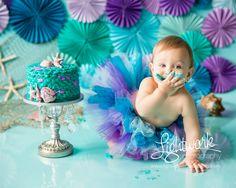 Mermaid 1st Birthday Cake Smash Photo, Custom Cake, Tutu and Props by Lightwork Photography, Fondant Seashells by Seasonably Adorned on Etsy.com, teal, turquoise, purple, lavender, seashells, fish netting, paper fans, rosettes, pinwheels, one year