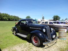 1936 Rumble seat with front and back split windshields.