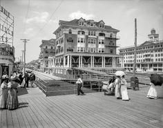 "The Jersey Shore circa 1910. ""St. Charles and Rudolf hotels, Atlantic City."" From the heyday of the Boardwalk, parasol and rolling chair. Shorpy Historic Picture Archive - 1910 high-resolution photo"