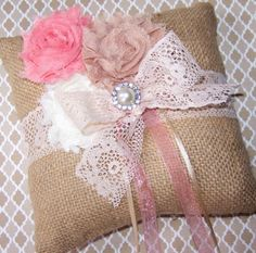 This is one of my new styles of ring pillows. Love that coral is so in right now!  Ring Bearer Pillow  Shabby Chic Burlap Rustic Ring by itsmyday, $36.00