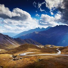 Emerging from the Hochtor Tunnel at the top of the Grossglockner High Alpine Road, the view south in Austria's Carinthia province takes in a few of the route's 38 hairpin bends. Winding for 30 miles through Hohe Tauern Natinal Park, it's Austria's highest, most hair-raising drive // photo by Matt Munro #austria #road #alps #mountain #grossglockner