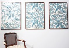 The art is wallpaper inside IKEA Ribba frames.  One of the frames is covering up an electrical panel -- great idea.