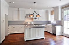 white cabinets, black granite, dark wood floors :)