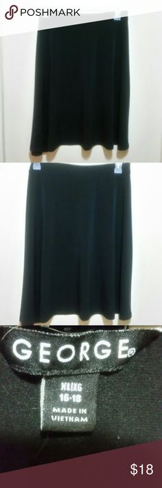 """George Go-to Black A-line Skirt Sz XL (16-18) This is the skirt you will always go back to wherever you're headed.  The perfect grab-and-go skirt, it doesn't wrinkle & is the perfect weight all year long. Wear it with tights & boots, hose & heels, or some cute sandals in the summer. Perfection.  :) 24"""" length and 36"""" waist unstretched. (Stretchy material ) George  Skirts Midi"""