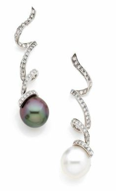 DIOR | Cultured Pearl and Diamond earrings set in white gold | each formed of squirming brilliant cut diamonds holding a cultured pearl. Signed Dior.