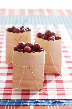 Send guests off with something sweet-but-tart by loading up small kraft paper bags filled with fresh cherries and tied with baker's twine.