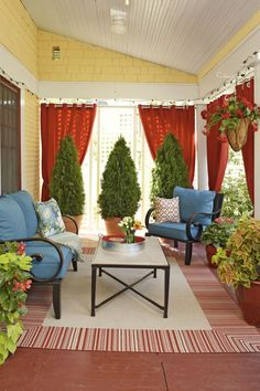 Bring life to your patio with greenery and outdoor lighting. Outdoor curtains, Porch 30 Rustic and Romantic Patio Design Ideas for Backyar. Outdoor Rooms, Outdoor Living, Outdoor Furniture Sets, Outdoor Decor, Outdoor Curtains For Patio, Blue Furniture, Small Front Porches, Decks And Porches, Small Patio