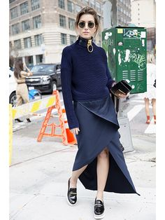 The Best Beauty Street Style From NYFW Spring 2016: Carmen Hamilton's navy sweater, wrap skirt and extra-large choker necklace | allure.com