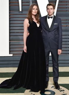 Keira Knightley in Valentino couture with husband James Righton at the Vanity Fair Oscar party