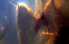 A huge gas and dust pillar in the Trifid Nebula, punctuated by a smaller pillar pointing up and an unusual jet pointing to the left HST)