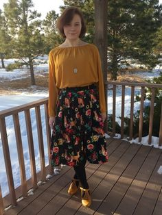Give your alluring air a complementary visual enchantment with this black midi skirt! Home to a rich print of forest-dwellers, floral designs, and a velveteen belt, this pleated garment harmoniously combines the wild with the serene, just like the fierce fashionista who wears it.