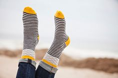 Jumping Jacks by Plucky Knitter Design  Stripes, diamonds, twists, and slips, it's all right here in one little fun package! Worked top-down these socks are a great project for on-the-go knitting… and all those pops of color? Let's play and knit at the same time!