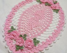 crocheted oval doily pink and white  spring  colors