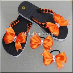 woven flip flops These flip flops are woven with premium grosgrain ribbon in orange and black. The bottom edge is lined with silver metallic ribbon and a beautiful pinwheel bow