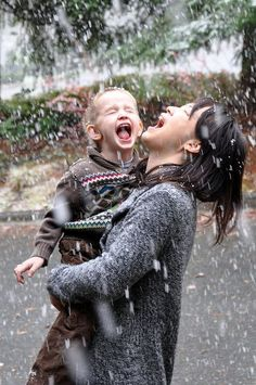 mother and child enjoying the rain.