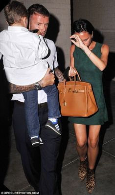 Victoria Beckham wearing Hermes Birkin Bag in Tan and Christian Louboutin Manamouk Ankle Boots.