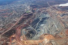 Fimiston Super Pit, near Kalgoorlie, Western Australia. The mi km) long, mi km) wide and 1870 ft m) deep pit has an oblong shape, and it produces more than 28 tons ounces) gold per year. Gold Miners, Travel General, Western Australia, Bouldering, Grand Canyon, Tourism, Photos, The Incredibles, Earth