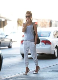 Shop Kate Beckinsale's look for $87: http://lookastic.com/women/looks/grey-tank-and-black-shopper-handbag-and-white-sweatpants-and-white-heels/1502 — Grey Tank — Black Leather Shopper Handbag — White Sweatpants — White Leather Heels