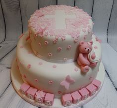 Girl's christening cake with name blocks, teddy, butterflies and cross