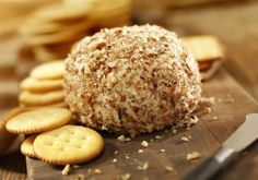 This salmon appetizer ball is made with cream cheese and canned salmon, flavored with a little horseradish and dill. Try this recipe at your next party.