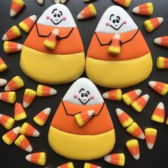 Candy corn holding a candy corn Thanksgiving Cookies, Fall Cookies, Iced Cookies, Cute Cookies, Royal Icing Cookies, Holiday Cookies, Cupcake Cookies, Cupcakes, Onesie Cookies
