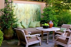 Comfortable seating and outdoor art make this space an inviting place to hang out in. Pillows, throw blankets, side tables and area rugs all add instant coziness.