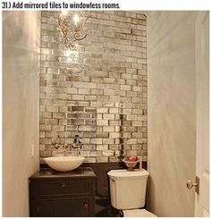 Mirrored tiles in bathroom without windows