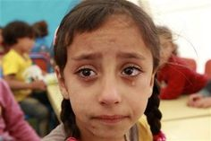 A Syrian child refugee cries during the fourth day of school at Al Zaatri refugee camp.
