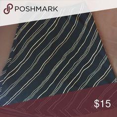 Dress Barn skirt, 8 Black w/tan stripes. Elastic waist. Polyester. Dress Barn Skirts