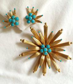 Stunning starburst set by Hobe.  https://www.etsy.com/listing/237666571/hobe-vintage-starburst-jewelry-set
