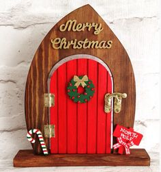 Lovely Hand Painted Christmas Fairy Elf Door Freestanding with opening door This door measures 21cm high x 18.5cm wide approximately Other doors are available. These items can also be purchased individually or in other sets. Please take a moment to view my other items. Please do not hesitate to contact me if you would like a specific colour scheme. Please note that this item is for decoration only and is not a toy. Children should be supervised at all times. Door does not actually ope...