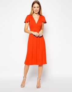 """Midi dress by ASOS Collection Lightly textured satin Wrap v-neckline Hook and button fastening Frill sleeves High waist seam Regular fit - true to size Machine wash 100% Polyester Our model wears a UK 8/EU 36/US 4 and is 175cm/5'9"""" tall ABOUT ASOS COLLECTION Directional, exciting and diverse, the ASOS Collection makes and breaks the fashion rules. Scouring the globe for inspiration, our London based Design Team is inspired by fashion's most covetable trends"""