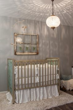 Joanna Gaines accessorized the nursery with an antique window wall-hanging, green glass vases and mobile with carved birds.