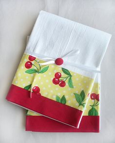 """Cherry towels for your vintage, retro or modern yellow kitchen! Aunt Martha's premium flour sack towel with designer cotton fabric accent. The cherries on yellow polka dot cotton fabric banding measures 3"""" wide with a 1.5"""" wide red fabric hem on one side of the towel. A hanger loop is in one corner. 100% cotton. Aunt Martha's premium flour sack towel is soft, absorbent, lint-free and thicker than the regular flour sack towels. While Aunt Martha's premium flour sack towels are the best flour…"""
