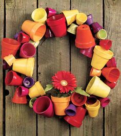 Tiny terracotta pots painted different colours makes a great wreath