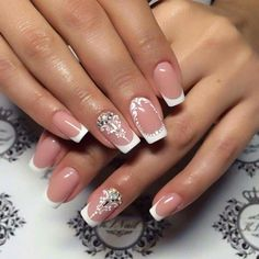 Elegant french tip nails with rhinestones and scroll work