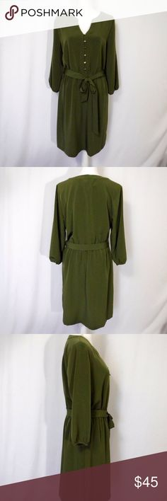 "NWT Covington Army Green Dress Size L/G NWT Covington Army Green Dress Size L/G  Lite Weight Silver Tone Buttons  Elastic Waist Matching Cloth Belt  100% Polyester   New With Tag   All Measurements Posted Below are Aprox. & Taken While Laying Flat  Shoulders: 17"" Under Arms: 20""(40)  Sleeves: 19/12"" Length: 38.5""  Please Ask Any Questions You may Have Before Purchasing.  Smoke & Pet Free Home  Please Check Out My Other Items  Inv#266 Covington Dresses Midi"