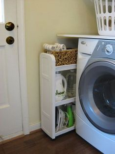 This is ingenius!! Conceal a somewhat cute rolling caddy by your washer/dryer for easy access to the important stuff :)