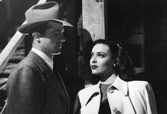 A shot from Fallen Angel, with Dana Andrews and Linda Darnell. He's handing her a line, and she isn't buying.