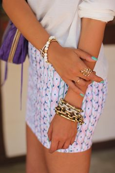 Love this jewelry - esp. the bracelets on the right hand and the rings.