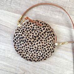 Leopard print hair on hide circle bag