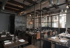 This is a restaurant, but it would look cool at home.  industrial environment restaurant interior design