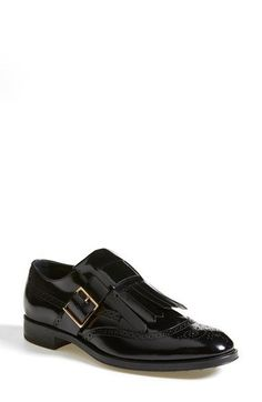 """Free shipping and returns on Tod's Kiltie Oxford (Women) at Nordstrom.com. <p><B STYLE=""""COLOR:#990000"""">Pre-order this style today! Add to Shopping Bag to view approximate ship date. You'll be charged only when your item ships.</b></p><br>A gleaming square side buckle and kiltie fringe lend menswear-inspired flair to a glossy brogued oxford crafted in Italy."""