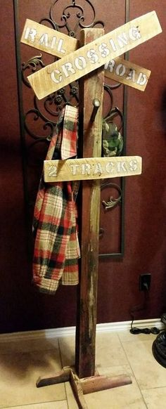 """#CoatRack, #Entrance, #HatRack, #RailroadCrossingSign, #RecyclingWoodPallets Add handy storage for your coats, hats and more with thisRailroad Crossing Sign Pallet Coat Rack. I made this using an old 4x4"""" post, a few well-placed pallet pieces and railroad spikes for the coat rack.  Dare to be different and add"""